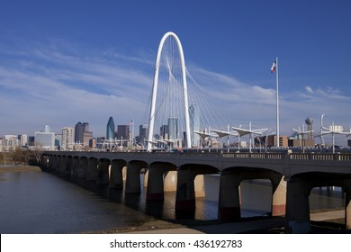 The new Continental Pedestrian and Margaret Hunt Hill Bridges that cross the Trinity River in Dallas, Texas. The bridge uses a unique design of a 400-foot steel arch and cables to support the bridge.