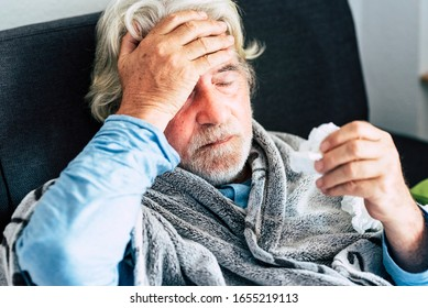 New coronavirus CoVid-19 outbreak situation with pandemic epidemic warning - adult caucasian senior old man with fever symptoms like illness cold seasonal influenza - people and virus concept