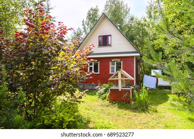new cottage and well on backyard in russian village in sunny summer day