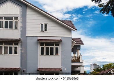New cozy house with balcony on blue sky background