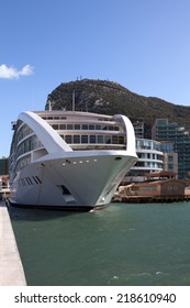 New cruiseship moored at Gibraltar marina; Rock of Gibraltar in the background