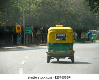 NEW DELHI, INDIA—MARCH 2018:  Back view of an auto cycle rickshaw traveling on a road in New Delhi.