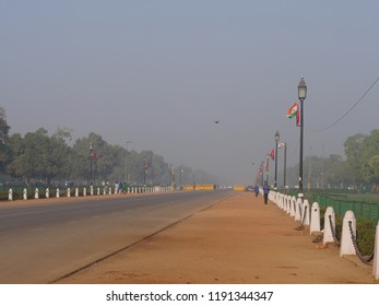 NEW DELHI, INDIA—MARCH 2018: Hazy skies early in the morning in New Delhi. View with the India Gate behind.