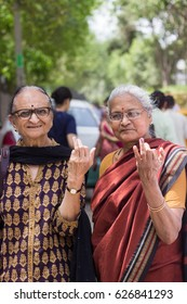 New Delhi - APRIL 23, 2017: New Delhi elections 2017 Women show their  ink stained index fingers after casting her vote for the MCD elections 2017 at a polling booth in New Delhi, India.