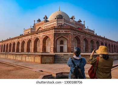 New Delhi - December 25, 2018 : Asian vintage style Photographers taking a photo of Humayun's Tomb, influenced by Persian architecture. Humayun's tomb is a UNESCO World Heritage Site since 1993.