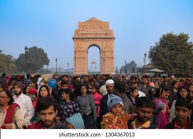 New Delhi - December 25, 2018 : Crowd of Indian people walking in front of India gate, a memorial to the Indian soldiers who lost their lives during the First World War.