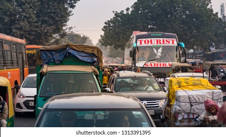 New Delhi - December 25, 2018 : Traffic congestion on Old Delhi street. Vehicles, cars, bused, bicycles and rickshaws on road.