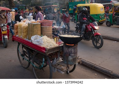 New Delhi - December 25, 2018 : A Indian local three wheel food cart for selling popcorn and nuts. India local street food.