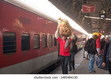 New Delhi - December 26, 2018 : India people walking and waiting a train at New Delhi railway station, one of the busiest railway stations in India, platform with foggy. India railway.