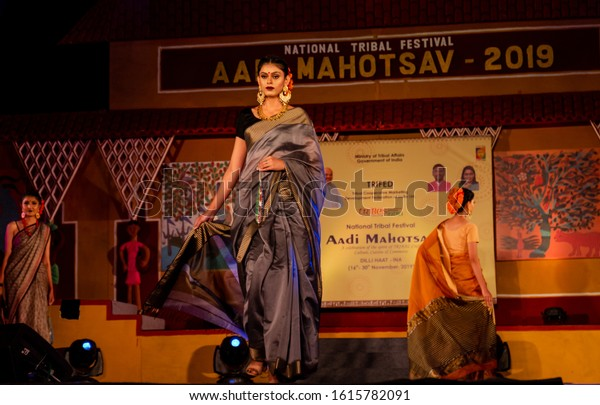 New Delhi, Delhi/India - 23 Nov 2019 :  Young and beautiful Indian female/model performing ramp walk in saree at the fashion event in delhi to showcase the hand made products made by tribal people