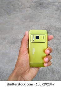 New Delhi, Delhi/India - mar 29, 2019: Nokia n8 isolated on background in hand. Old Nokia limited smartphone, phone. Nokia's most popular phones. Hmd global Home of Nokia smartphone. Symbian OS.
