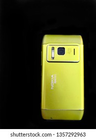 New Delhi, Delhi/India - mar 29, 2019: Nokia n8 isolated on black background. Old Nokia limited smartphone, phone. One of Nokia's most popular phones. Hmd global Home of Nokia smartphone. Symbian OS.