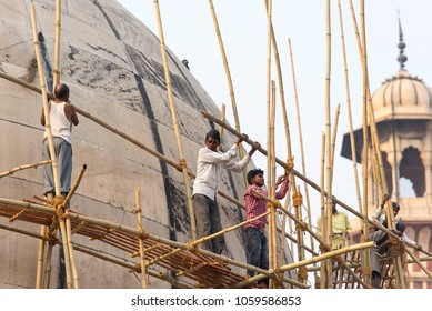NEW DELHI - FEB 24: Jama Masjid Mosque  under construction and Indian workers in New Delhi on February 24. 2018 in India