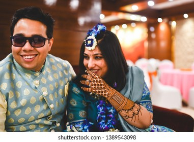 New delhi, Delhi, India 01/24.2019 : Bride and groom laughing mischievously on a joke while everyone else awaits them.