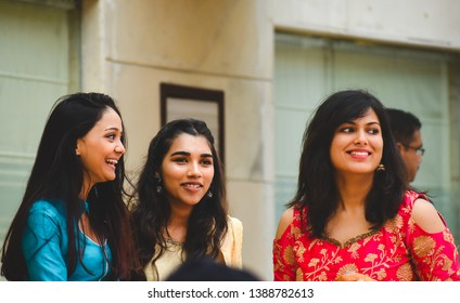 New delhi, Delhi, India 01/24.2019 : Three girls in traditional wear laughing candidly.