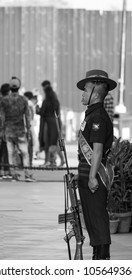 New Delhi, Delhi / India - 03/10/2018: An armed solider standing tall in concentration on India Gate around Amar Jyoti Jawan.