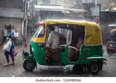 New Delhi / India - 07 20 2018: Heavy rainfall in Delhi causes floods that is a problem for transportation as auto rickshaws.