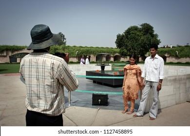 New Delhi, India, 09/03/2006: souvenir photo on the tomb of Gandhi in New Delhi, India