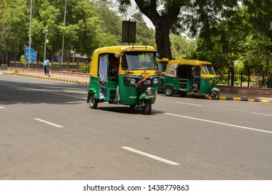 New Delhi, India, 2019. Emphatic looking CNG fueled auto rickshaw, standing on the corner of road. It's a popular urban transport on Indian roads in Mumbai, Pune, Lucknow, Jaipur, Hyderabad, Bangalore