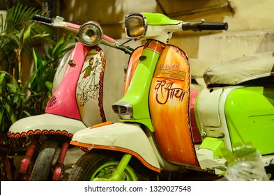 New Delhi, India, 2019. Fancy colorful Vespa scooters on display in Hauz Khas Village, Delhi