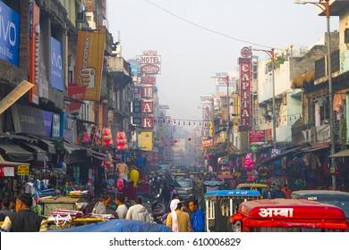 NEW DELHI, INDIA - 21 JANUARY 2017: Busy Indian Street Market in New Delhi, India. Delhi's population surpassed 18 million people.