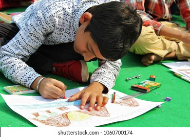 New Delhi, India - 21st February 2016: Boy participated in a Painting Competition during 29th Garden Tourism Festival 2016, GARDEN OF FIVE SENSES