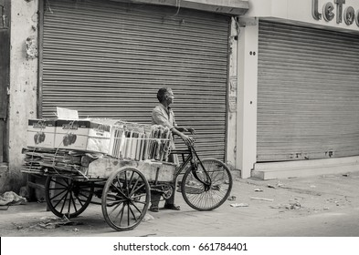 NEW DELHI, INDIA -23 APRIL 2016 : a monochrome picture of a waste cardboard collector in India