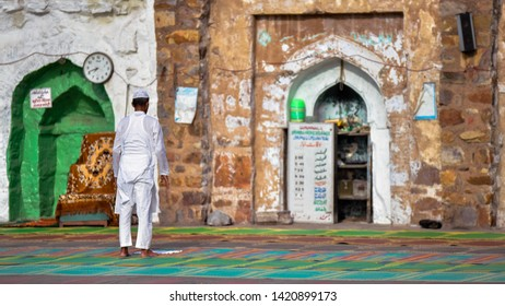 New Delhi, India 5th June 2019: A Muslim man offering traditional Namaz prayers on the occasion of Eid-Al-Fitr. He is dressed in a traditional white kurta-pyjama and a white skullcap