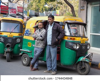 New Delhi, India. 6th February 2020. Local Indian Taxi drivers standing together and having a quick discussion.
