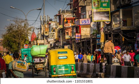 New Delhi / India - April 12 2017: Busy street Chandni Chowk in Old Delhi downtown area with crowds of people, yellow rickshaws. The busiest market in the world. Typical Delhi, India.