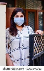 New Delhi, India - April 12, 2020 - A lady wearing a mask as a protection from coronavirus or Covid-19. The infection has killed over 100,000 people globally. WHO has suggested mask use a precaution