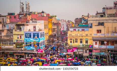 New Delhi / India - April 18 2017: Busy market streets with colorful houses, buildings and crowds of people, rickshaws near Jama Masjid in Old part of New Delhi, India.