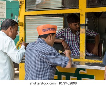New Delhi, India - April 25, 2018: People eating at a road side food outlet.