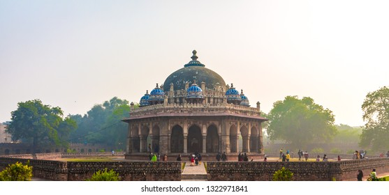 New Delhi, Delhi / India - April 25 2018: Isa Khan's tomb is beautifully adorned with varnished tiles, ornate awnings, lattice windows and ample verandahs held up by pillars.