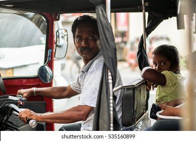 NEW DELHI, INDIA - DECEMBER 09, 2016 : Hindu man riding on tuk-tuk moto taxi on the street New Delhi.