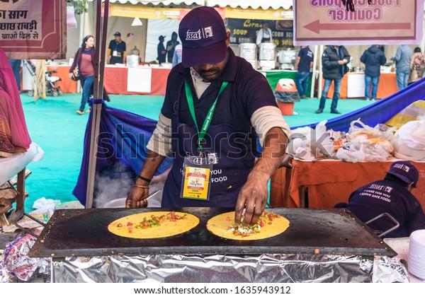 New Delhi, India - December 29, 2019: Food vendor selling local masala dosa at National Street Food Festival in New Delhi, India