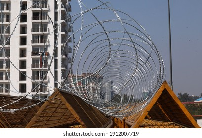 New Delhi, India, Feb 08, 2020: Iron barricades with concertina wire erected by police forces as farmers protest against BJP government new three farm laws at Ghazipur Delhi Uttar Pradesh border
