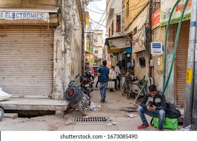 NEW DELHI, INDIA - feb 6th 2020:  Street scene in india. Indian city street full of people