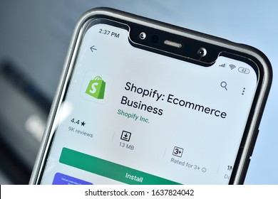 New Delhi, India - february 06, 2020: using Shopify app on smartphone, Shopify application on app store, drop shipping, make e-commerce website