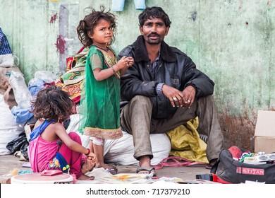 New Delhi, India - February 16, 2015: Homeless family in the streets of Old Delhi