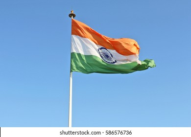 New Delhi, India - Feburary 24, 2017: This 60 feet in width and 90 feet in length Tiranga, the national flag of India hoisted at Rajiv Chowk, New Delhi is one of the largest national flags of India.