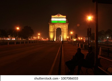 New Delhi, India - January 21, 2108: Officers from national security forces seen guarding the India gate illuminated in tricolour ahead of Republic day parade in New Delhi.