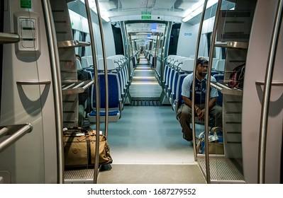 New Delhi, India - Jul 21, 2011: Interior of Orange Line or Delhi Metro Airport Express.
