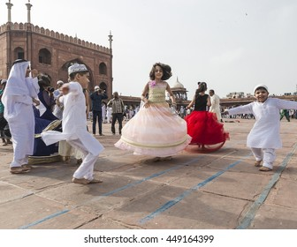 New Delhi, India - July 07, 2016 : Teens are dancing and enjoying after  Eid al-Fitr prayer at the historic Jama Masjid lawn near Red Fort in New Delhi today morning on the occasion of Eid-ul-Fitr.