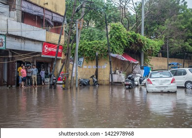 New Delhi / India - July 16 2018: Flooded streets with onlookers on a midday after the rains in the capital.