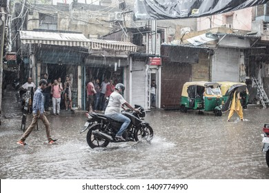 New Delhi / India - July 20 2018: Huge rainfalls have left the streets flooded in the capital on a late afternoon