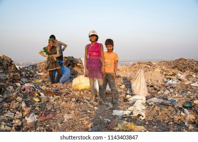 New Delhi, India - July 25, 2018: Poor children collecting garbage from landfill site in Tekhand to meet their livelihood.