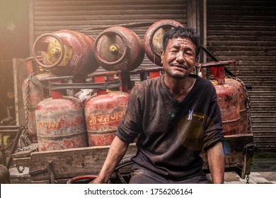 New Delhi, Delhi/ India- June 15 2020: A gas delivery man smiles for a picture near Jama masjid,