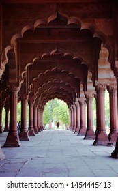 NEW DELHI / INDIA - JUNE 2019: Arcades of Red Fort, also called Lal Qila at night in Delhi India. Detail of Indian architecture of the Mughal dynasty. Interior view of Red Fort or Lal Qila
