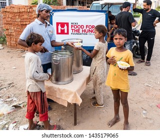New Delhi, India - June 23, 2019: A group of children taking their meal distributed by an NGO